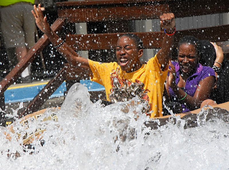 04-07-10  --feature six flags spring break 01--  Tray Greene, 14, left, and Jasmine Smith, 16, get a refreshing spray of water as they ride the Log Jamboree at Six Flags Over Georgia on the warm Wednesday afternoon.  STAFF/LAURA MOON.