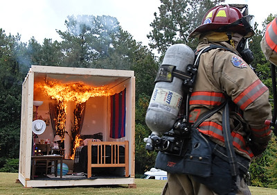 10-11-11  --ksu dorm burn 05--  The fire begins to fill the simulated dorm bedroom at Kennesaw State University with Cobb County Fire and Emergency Services present to extinguish the fire.  STAFF/LAURA MOON.