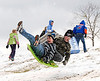 02-13-10  --snow day play 01--  Austin Hester, 10, of Kennesaw, left, and Hunter Jones, 11, of Acworth fly into the air after hitting a bump as they sled down a hill at Lost Mountain Park in Powder Springs on Saturday afternoon.  STAFF/LAURA MOON.