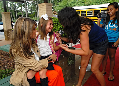 08-09-12  --hickory hills first day 02--  From left, Hickory Hills Elementary new principal Kristen Beaudin tries to console first grader Michelle Olah, 6, as her mother brings her to school for the first day of class on Thursday morning.  STAFF/LAURA MOON.