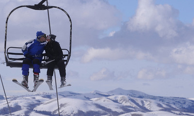 Up in the clouds Bill Schaefer/Idaho State Journal Jon Stoner, left, and Terri Campbell find a way to pass the time while riding the Apsen lift at Pebble Creek Ski Resort Tuesday afternoon.