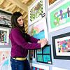 Kelley Lee, art teacher at Avon Heritage Elementary, installs student artwork for the 4th Annual Avon Fine Arts Extravaganza, at Avon Isle, 37080 Detroit Rd, on Apr. 23.  The District Art show is open Tuesday from 4 p.m. to 8 p.m. and Thursday from 4 p.m to 6 p.m.  STEVE MANHEIM / CHRONICLE