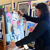 Karen Busch, art teacher at Avon High, installs student artwork for the 4th Annual Avon Fine Arts Extravaganza, at Avon Isle, 37080 Detroit Rd, on Apr. 23.  The District Art show is open Tuesday from 4 p.m. to 8 p.m. and Thursday from 4 p.m to 6 p.m.  STEVE MANHEIM / CHRONICLE