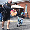 "KRISTIN BAUER / CHRONICLE <br /> Luke Thorne, 5, of Grafton, practices safe riding technigues with Sgt. Mark Bungard from the Lorain County Sheriff's Office, on Sunday, April 22 during the ""Bike Rodeo"" a Bicycle Skills Clinic at North Eaton Christian Church. Students and their families were invited to partake in the event to gain bike handling skills and to learn about safe bike riding."