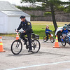 "KRISTIN BAUER / CHRONICLE <br /> Avon Lake Police Department Patrolman Anthony Fabrizi instucts students on signaling as they make their way through an obstacle course on Sunday, April 22 set up at the ""Bike Rodeo"" a Bicycle Skills Clinic at North Eaton Christian Church. Students and their families were invited to partake in the event to gain bike handling skills and to learn about safe bike riding."