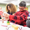 KRISTIN BAUER / CHRONICLE  <br /> Kylee Krasienko, 10, and Logan Ingle, 11, both of Lorain, work on frosting cupcakes that they will use for a cupcake Christmas Tree on Wednesday afternoon, December 6 at the Lorain Main Branch Public Library, for the Cupcake Wars program.