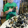 "Ian Murphy, 9, of Parma, looks through fishing casting reels at the Holy Mackerel Fishing Tackle Flea Market at New Russia Township Hall, 46300 Butternut Ridge Road, Apr. 5. The free event, hosted by Mike and Leon Wohlever of Lorain County Casters. features thousands of rods, reeles, lures and tackle. The market is open Friday from 9 a.m. to 7 p.m., Saturday from 8 a.m. to 6 p.m., and Sunday from 9 a.m. to 5 p.m.  For more info.  <a href=""http://www.holymackereltackle.com"">http://www.holymackereltackle.com</a>  STEVE MANHEIM / CHRONICLE"