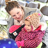 KRISTIN BAUER / CHRONICLE <br /> Heather Thomas, of Avon, holds her youngest Gianna, 4 weeks, and dances with her daughter Jaelle, 1, during a program put on by the Music Therapy Enrichment Center, Inc., located in Westlake, while at the inaugural event held at Every Child's Playground, in Avon, on Saturday morning, April 14.