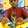 Gus Dutta, 8, of North Ridgeville, builds a lego ninja transport at Lego Fun Day at North Ridgeville Public Library Jan. 19.  Over 45 students built their own Lego creations. It was students' day off from school for North Ridgeville Records and Professional Day. STEVE MANHEIM / CHRONICLE