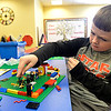 Quinn Melvin, 7, of North Ridgeville, builds a lego ninja headquarters at Lego Fun Day at North Ridgeville Public Library Jan. 19.  Over 45 students built their own Lego creations. It was students' day off from school for North Ridgeville Records and Professional Day. STEVE MANHEIM / CHRONICLE