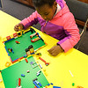 Kira Dutta, 5, of North Ridgeville, builds a lego creation at Lego Fun Day at North Ridgeville Public Library Jan. 19.  Over 45 students built their own Lego creations. It was students' day off from school for North Ridgeville Records and Professional Day. STEVE MANHEIM / CHRONICLE