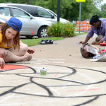 Friends Victoria Krejci, 16, of Camden Township, and Jullion Fenderson, 16, of Oberlin, create large pictures on the sidewalk. KRISTIN BAUER | CHRONICLE