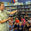 Outback Ray shows a black king snake at LaGrange Public Library on Sept. 18.  STEVE MANHEIM / CHRONICLE