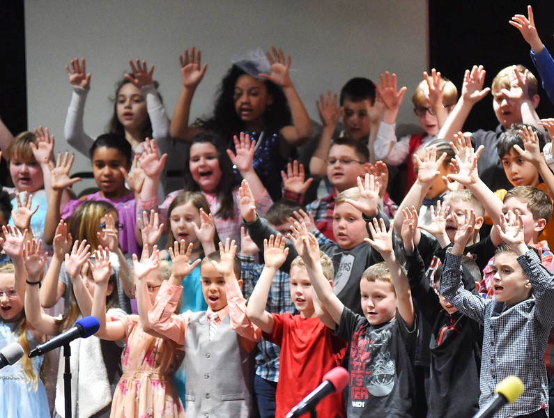 """KRISTIN BAUER / CHRONICLE<br /> Prospect Elementary School third grade students performed """"I Love The Mountains"""" at the Elyria High School Performing Arts Center on Tuesday night, March 13."""