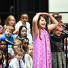 """KRISTIN BAUER / CHRONICLE<br /> Prospect Elementary School third grade students Avery Brookhart and Nandi Badat perform a solo during the """"A Journey Through Time"""" performance at the Elyria High School Performing Arts Center on Tuesday night, March 13. The students performed """"Erie Canal."""""""