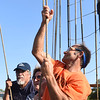 KRISTIN BAUER | CHRONICLE<br /> Ralph Saultz, of Lorain, his mother Terry Anthony, of Amherst, and Raul Rodriguez, of Cleveland volunteered to help lower the sails when the Pride of Baltimore II tall ship made its way back into Black River Landing on Monday afternoon, Sept. 5.