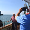KRISTIN BAUER | CHRONICLE<br /> Felix Rosario, of Lorain, is a World War II veteran of the U.S. Army, and has not stepped foot onto a boat since his time in the war ended in 1945.  Today, he had his photo taken by his son, Jose, also of Lorain, on the Pride of Baltimore II tall ship while sailing out into Lake Erie for an afternoon cruise.