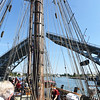 KRISTIN BAUER | CHRONICLE<br /> Guests aboard the Pride of Baltimore II tall ship watch as the ship makes its way under the lifted Charles Berry Bascule Bridge, in Lorain, on Monday afternoon, Sept. 5.