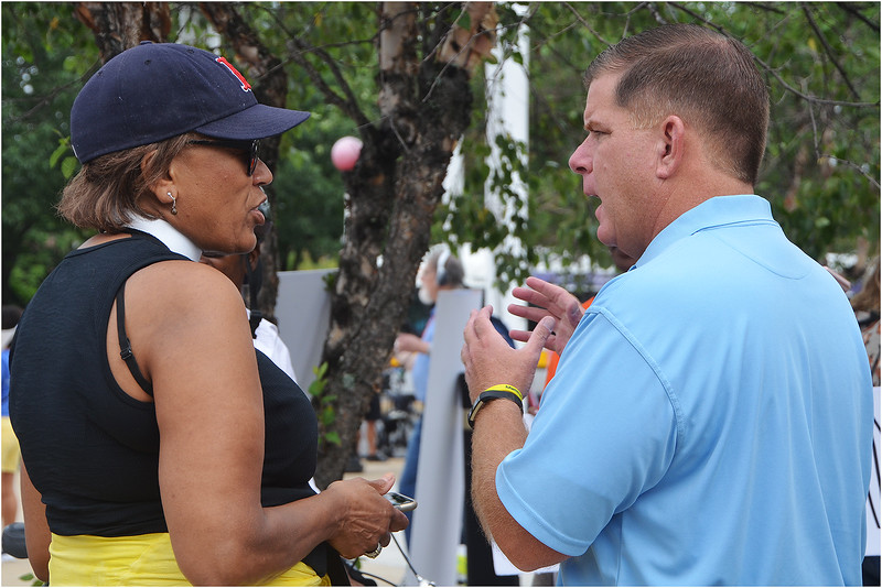 Rev. Liz Walker, Senior Pastor of Roxbury Presbyterian Church, talks with Boston Mayor Marty Walsh before the march.