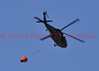 A fire attack helicopter that is dropping buckets of water on the fire incident in Black Forest, Colorado.