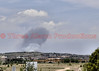 A large plume of smoke rising up, as seen from Care and Share on Constitution Avenue in El Paso County, Colorado.