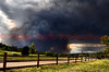 On June 26, 2012, the aggressiveness and forcefulness of the Waldo Canyon Fire building, as it gets ready to be blasted into the City of Colorado Springs by a thunderstorm, creating a disaster for residents.