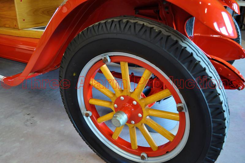 A wooden spoke wheel on a 1929 fire engine.