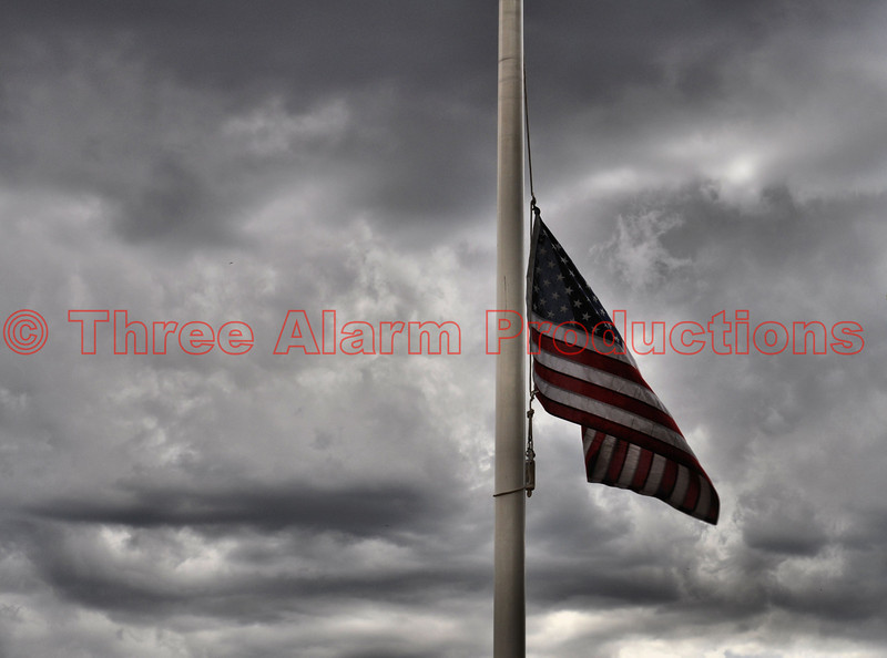 The American Flag being flown at half staff, at Cimarron Hills Fire Station No. 1 in Colorado.