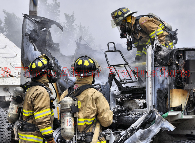 Cimarron Hills Firefighters working to fully extinguish a semi-truck fire in El Paso County, Colorado.