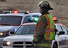 Firefighter Lancaster assisting with traffic control at a traffic accident scene in the Community of Cimarron Hills, Colorado.