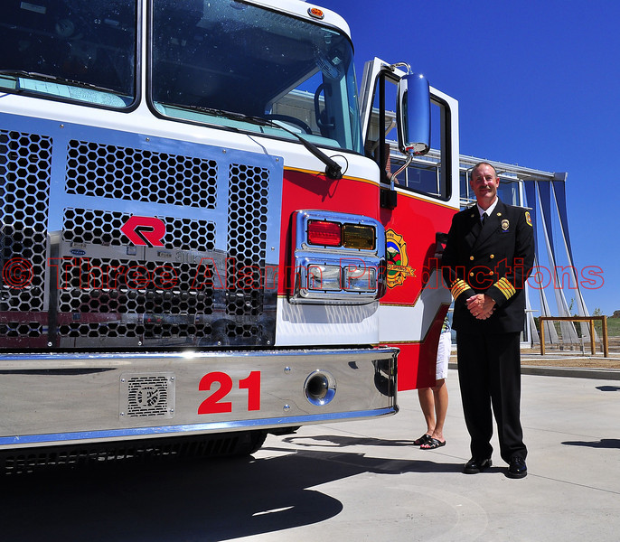 Colorado Springs Deputy Fire Chief Steve Dubay, standing next to Fire Engine 21 at the Grand Opening Celebration on August 29, 2013.