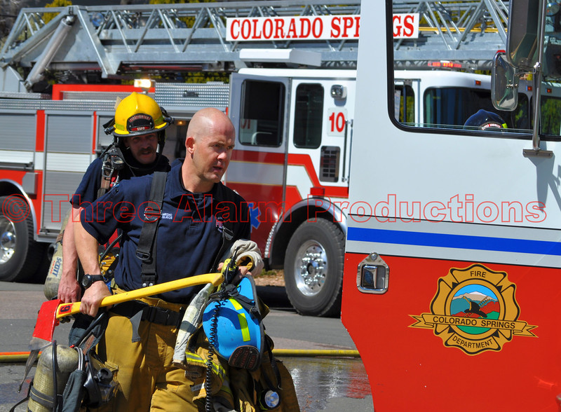 Colorado Springs Fire Fighters on the scene of a house fire.