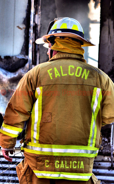 Battalion Chief Galicia with Falcon Fire Department, on the scene of a working structure fire.