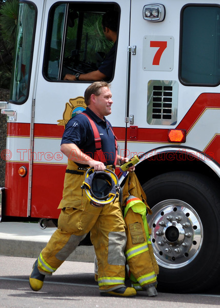 A firefighter with Colorado Springs Fire Engine 7 on the scene of a traffic accident.