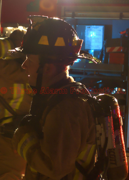 A Falcon Firefighter on the scene of a well-involved house fire in Cimarron Hills, Colorado.