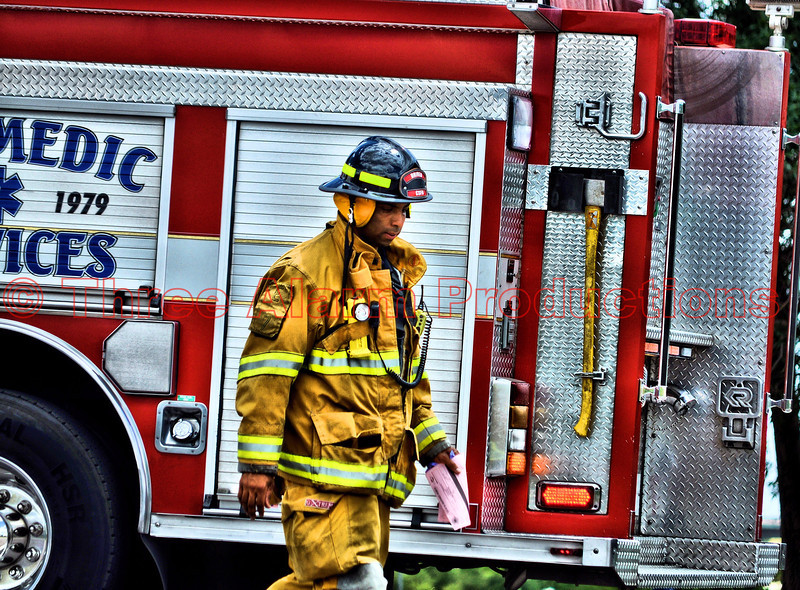 Colorado Springs Firefighter Lemons with CSFD Engine 7, on the scene of a traffic accident.