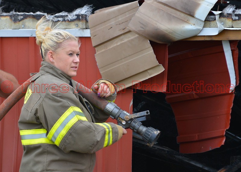 A Simla Firefighter on the scene of a barn fire in El Paso County, Colorado.