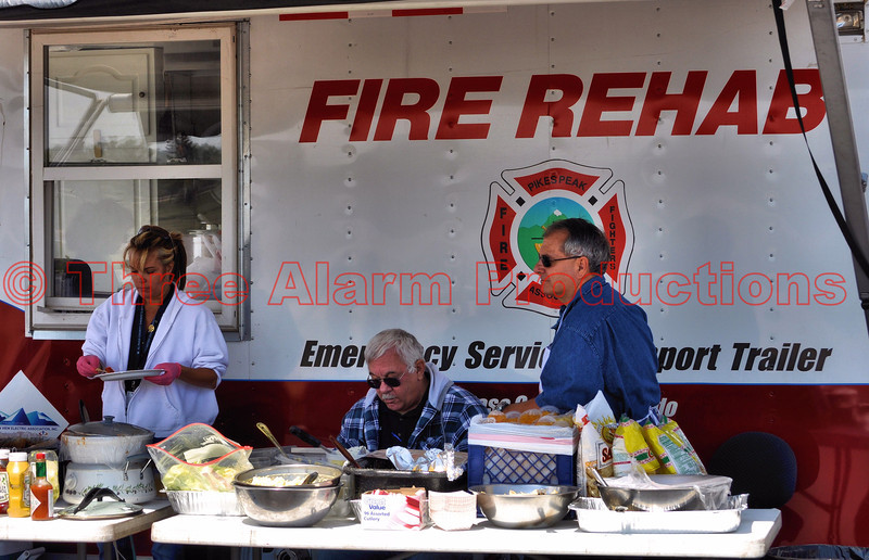 """The Pikes Peak Firefighters Association Emergency Services Support Trailer with staff serving great food to all those in attendance at the Peyton Fire 25 Year Celebration. A week later these resources and staff were dispatched to assist on the devastating Waldo Canyon Fire Incident. See more at: <a href=""""http://threealarm.smugmug.com/Journalism/People/Waldo-Canyon-Support-Drive-at/23781762_5GHvhs#!i=1926674482&k=v55w3wp"""">http://threealarm.smugmug.com/Journalism/People/Waldo-Canyon-Support-Drive-at/23781762_5GHvhs#!i=1926674482&k=v55w3wp</a>"""