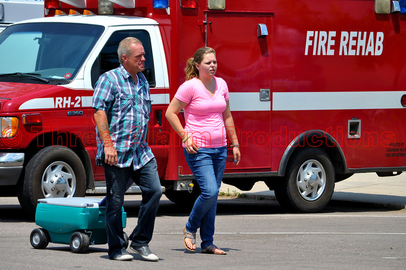 Volunteers delivering iced bottled water to Emergency Personnel at Colorado Springs Staging Area.
