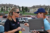 (L) Sunny Smaldino, Public Communications Manager, Colorado Springs Fire Department at the media staging area at Coronado High School for coverage of the Waldo Canyon Fire.