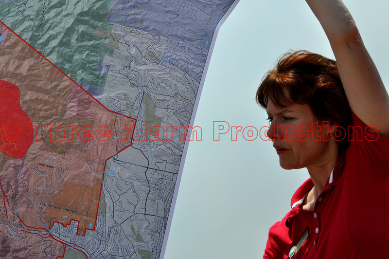 "Seen here is El Paso County Commissioner, District 3, Sallie Clark, showing me a map of fire activity and fire threatened areas of Colorado Springs, Colorado, United States of America, that are due to the massive Waldo Canyon Fire.<br /> Get more information about Sallie Clark at: <a href=""http://bcc.elpasoco.com/Pages/District3SallieClark.aspx"">http://bcc.elpasoco.com/Pages/District3SallieClark.aspx</a>"