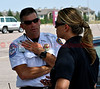 American Red Cross Supervisor, Jon Webb talking with Sunny Smaldino, Public Communications Manager, Colorado Springs Fire Department at the staging area at Coronado High School for the Waldo Canyon Fire.