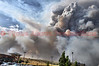Fire Storm blowing through Northwest Colorado Springs, Colorado destroying hundreds of people's homes as seen from Centennial and Fillmore. Many people had to evacuate instantly to save their lives. Roads in that are became gridlocked with people attempting to escape in their vehicles.