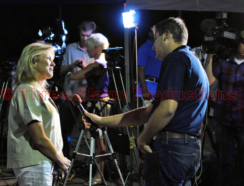 Andy Koen with KOAA News 5, doing an interview with an evacuee from the Waldo Canyon Fire.