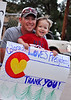 Colorado Loves Firefighters! Thank You! Dad and son out on the sidewalks of 31st Street and Colorado cheering firefighters as they pass by on their way to quarters for the night.
