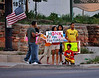 """""""HONK IF YOU LOVE FIRE FIGHTERS"""". What a great show of support seen by groups of people at the intersection of S 31st Street and W. Colorado Avenue, as they watched many fire fighters traveling through from their work on the Waldo Canyon Fire."""