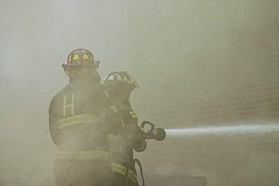 Fire fighters battle a blaze at Letoile Roofing Company in Haverhill, MA.