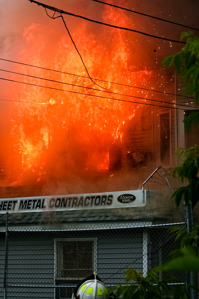 Flames take down power lines at a blaze at Letoile Roofing Company in Haverhill, MA.