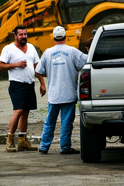 Onlookers kick back and drink beer as fire fighters battle a blaze at Letoile Roofing Company in Haverhill, MA.