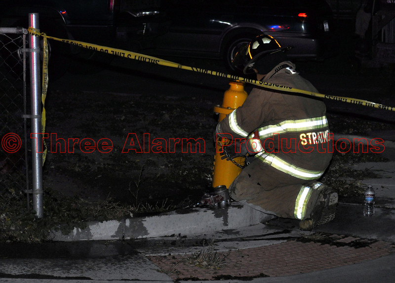 A Stratmoor Hills Firefighter putting the fire hydrant back in service, after it was used to supply Fire Engine 410 on a shed fire.